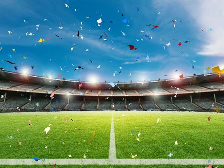 3d prestación celebración confeti en el fondo del campo de fútbol