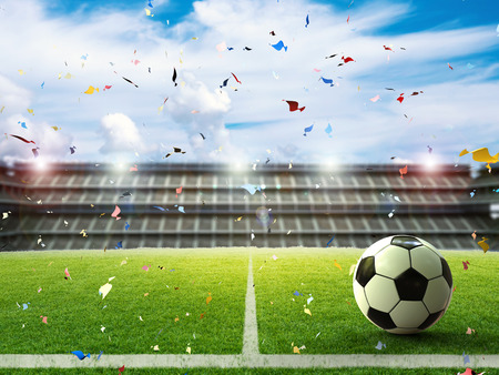 winning pitch: 3d rendering soccer ball on green field with blue sky Stock Photo