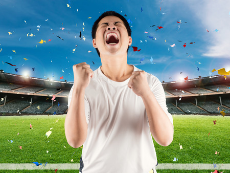 asian football fan celebrate with stadium and confetti background