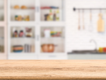cabinetry: wooden counter top with kitchen cabinet background