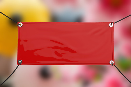 red blank vinyl banner hanging with rope