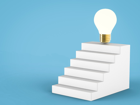 golden coins: business success idea with stack of golden coins and idea light bulb