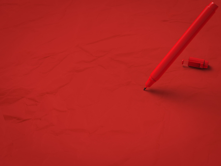 red pen on red background