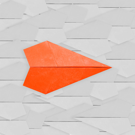 differentiation: differentiation concept with orange paper plane