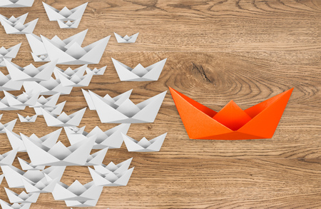 differentiation: leadership concept with paper boat leading Stock Photo