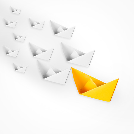 leadership concept with paper boat leading Stock Photo