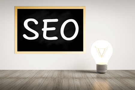 seo on blackboard with idea lightbulb