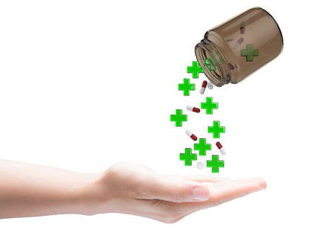 falling out: green cross and pills falling out of bottle