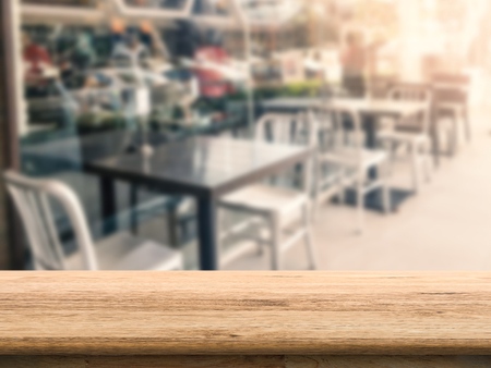 interior spaces: wooden table with empty restaurant background