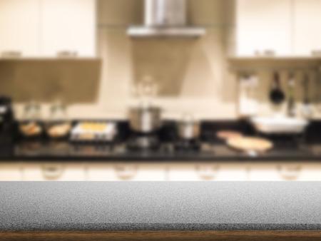 granite kitchen: granite counter with kitchen background Stock Photo