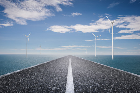 eco road concept with turbines and blue sea on blue sky background
