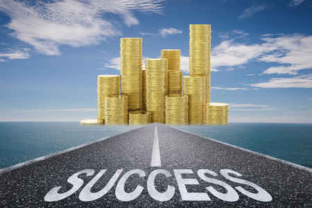 road to success concept with 3d rendered success text on asphalt road and stack of gold coins Stock Photo