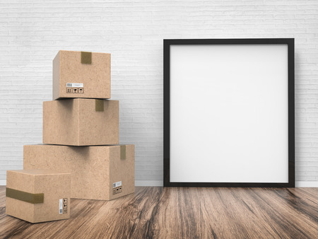 stockroom: blank black frame hanging on wall with carton box