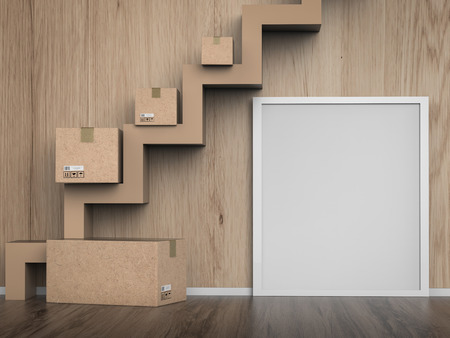 stockroom: blank white frame hanging on wall with carton box Stock Photo