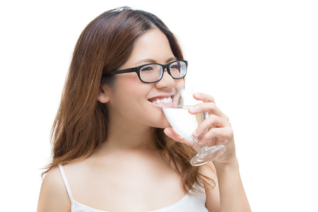 healthy woman drinking water isolated on white