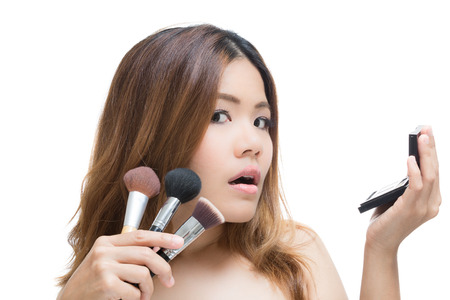 shocked face woman with hand holding make up brush and palette Stock Photo