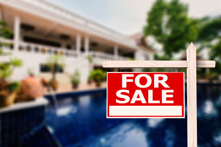 for sale sign: for sale sign at luxury house with pool background