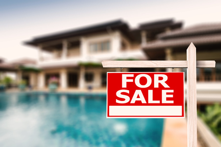 sale sign: for sale sign at luxury house with pool background