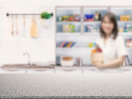 granite kitchen: grey granite counter with kitchen blurred background Stock Photo