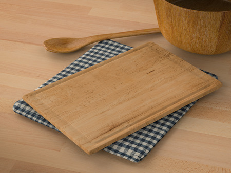trencher: wooden bowl with spoon and chopping board on wooden background Stock Photo