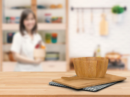 cabinetry: kitchenware on wooden counter with kitchen blurred background