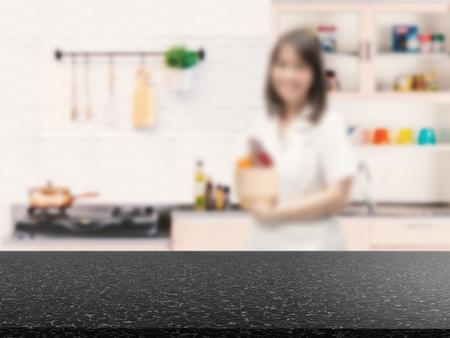 granite kitchen: black granite counter with kitchen blurred background