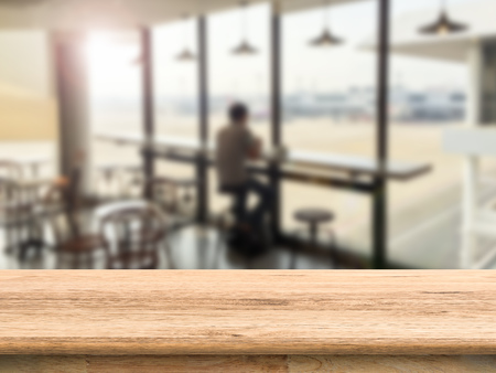 interior spaces: empty wooden counter top with cafe background