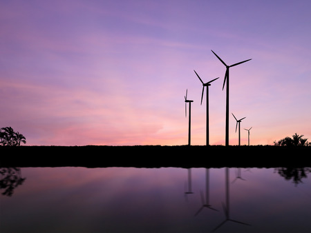 water mill: silhouette wind turbines with sunset sky background Stock Photo