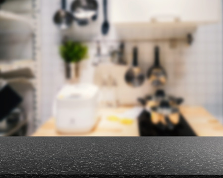 countertop: granite countertop with kitchen blurred background