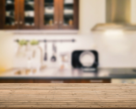 kitchenette: wooden counter top with kitchen blurred background Stock Photo