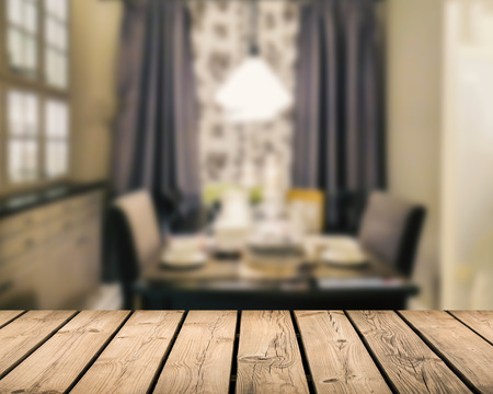 countertop: wooden countertop with dining room blurred background