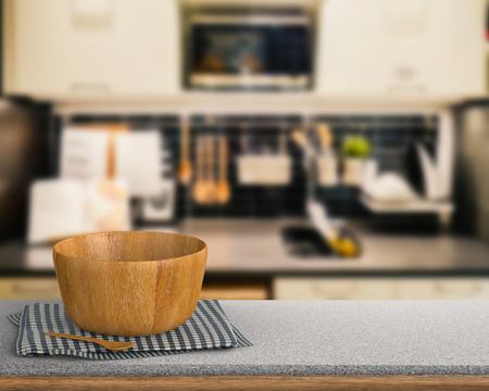 granite kitchen: kitchenware on granite counter with kitchen blurred background Stock Photo