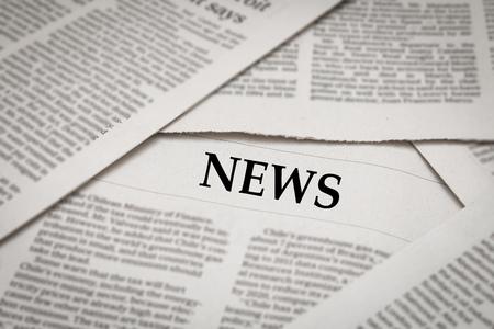 news headline on newspaper background Stock Photo