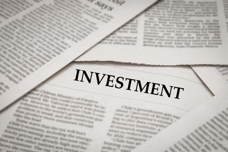newsgroup: investment headline on newspaper background Stock Photo