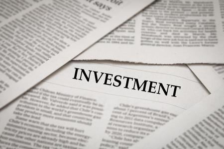 investment headline on newspaper background Stock Photo