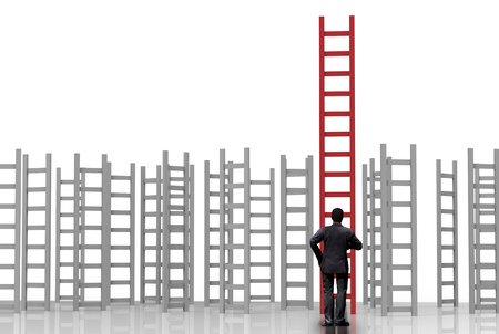 differentiation: rear view of businessman standing with ladder to success