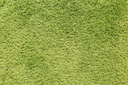 green background: green carpet background or green doormat background