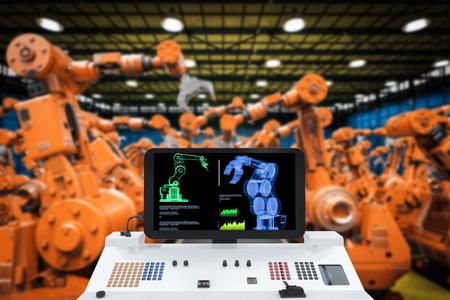 industria de la automatización con la pantalla del monitor 3d renderizado con los brazos robóticos Foto de archivo