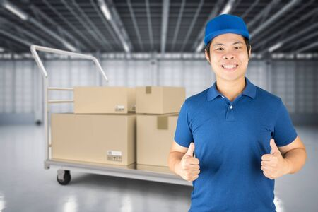 asian delivery man in distribution warehouse Stock Photo