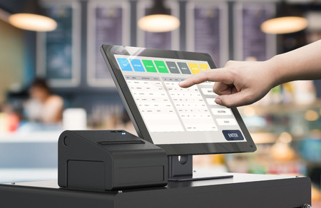 human hand working with 3d rendering cashier machine Standard-Bild