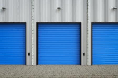 empty warehouse: 3d rendering warehouse exterior with shutter doors