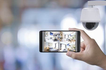 hand holding 3d rendering mobile connect with security camera
