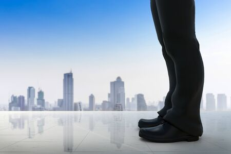 3d rendering businessman standing with cityscape background