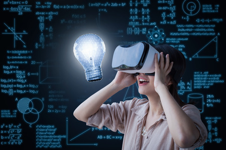 Creativity concept with 3d rendering polygonal light bulb and graphic on vr headset