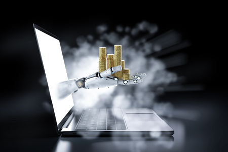 Financial technology concept with 3d rendering robot hold stack of coins out of computer notebook Reklamní fotografie