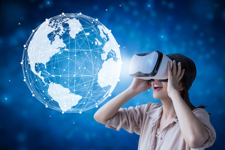 Asian woman wear vr headset and enjoy experience with world graphic illustration