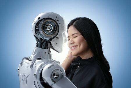 Asian woman happy living with cyborg or robot Фото со стока