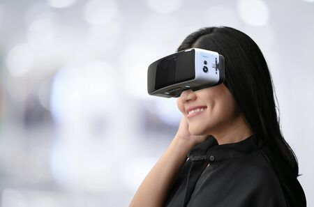 Asian woman wear vr headset and enjoy experience
