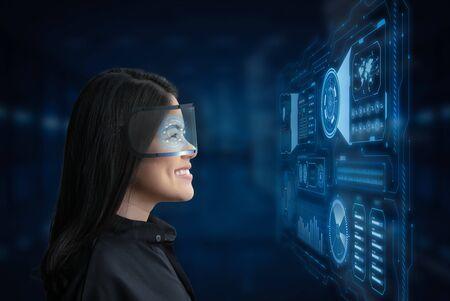 Asian woman wear goggle or headset and enjoy experience Фото со стока
