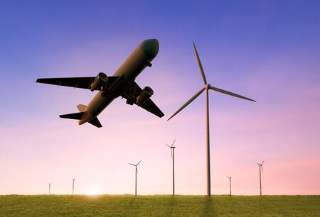 Green power for airline business concept with 3d rendering airplane fly above wind mill farm
